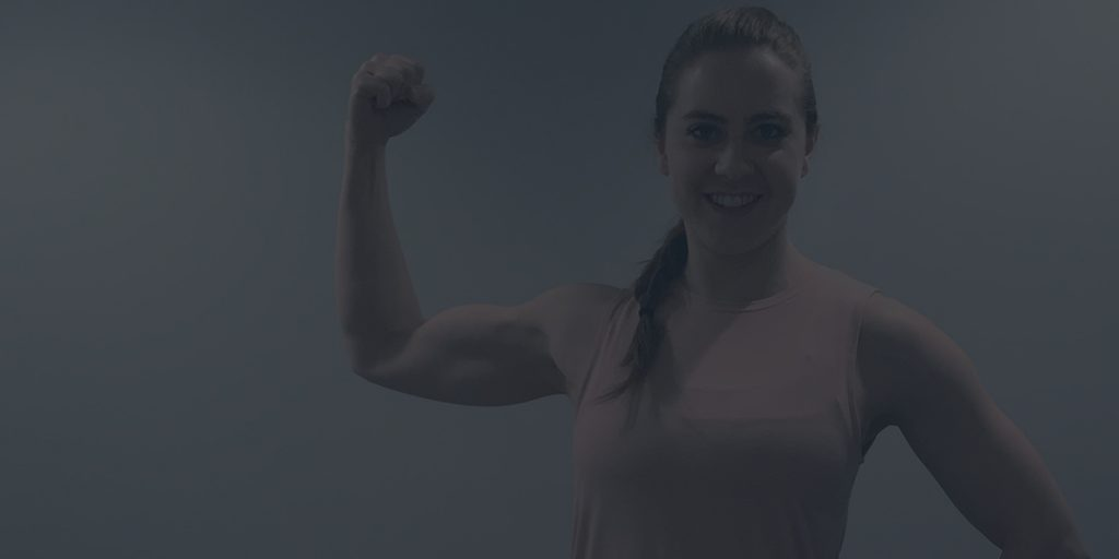 How to Use Your Period to Make You Stronger on Belle of the Barbell girl with muscle arm