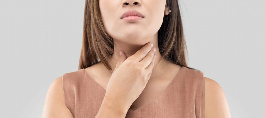Can I still work out if I have coronavirus? Dr. Elle has the answers at Belle of the Barbell: woman with sore throat