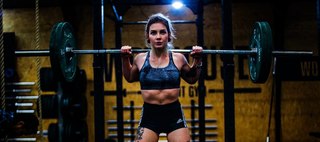 Does Glute Activation Work? What the Science Says at Belle of the Barbell Woman doing back squat