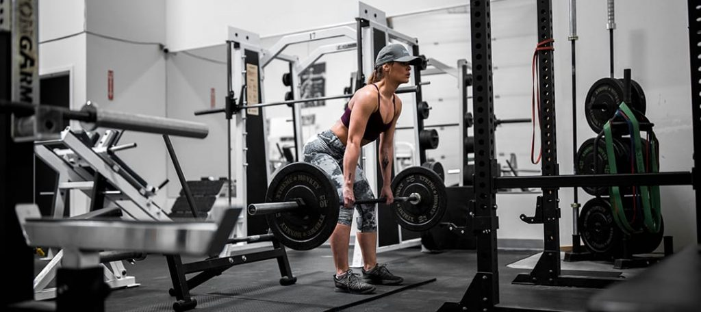 Does Glute Activation Work? What the Science Says at Belle of the Barbell Woman doing Deadlifts