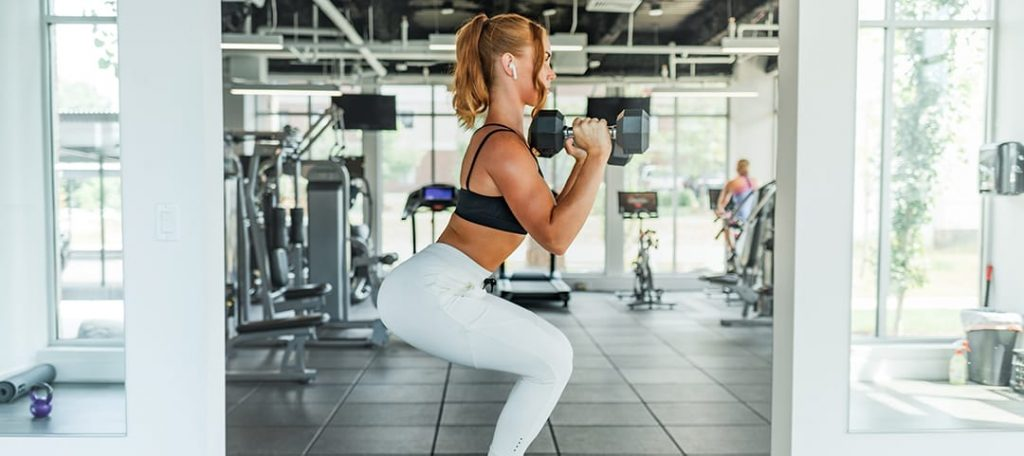 Does Glute Activation Work? What the Science Says at Belle of the Barbell Woman doing front squat dumbbells