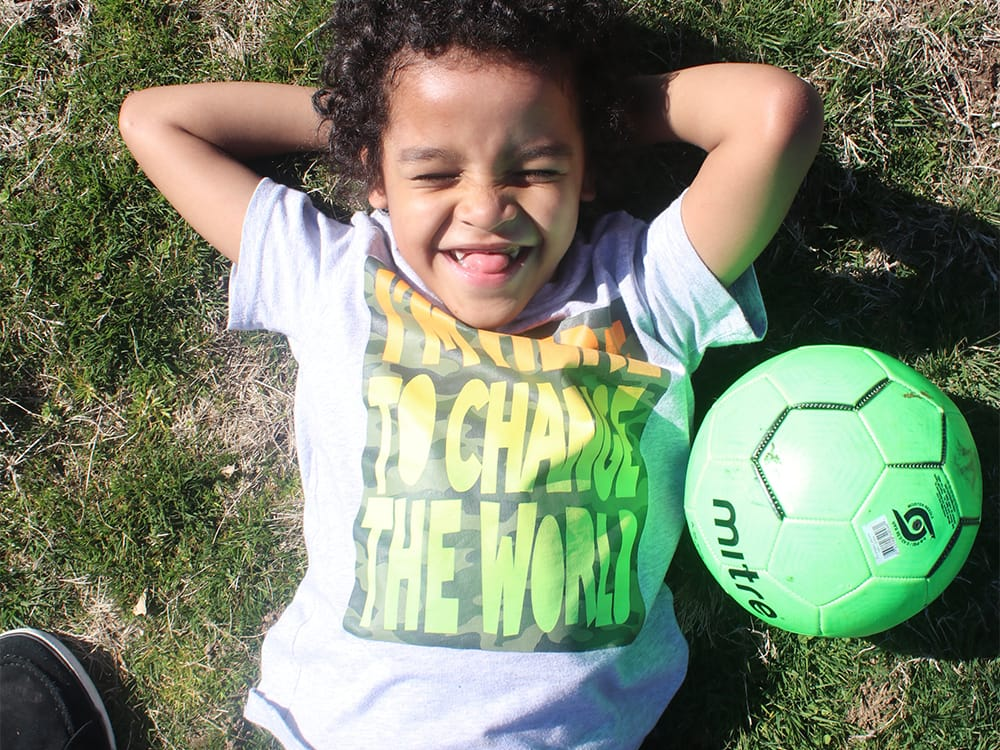Teaching PE at Home Kid Outside with Soccer Ball